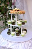 picture of three tier  - Wedding cake with cup cake style on a 3 - JPG