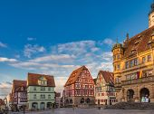 Marktplatz (market square) with half-timbered houses and Town Hall in Rothenburg ob der Tauber, Bava poster