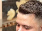 Male In Hairdressing Saloon, Close Up View. Interior Of Barbershop. Males Modern Hairdo. Selective S poster