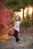 Girl In Autumn Park With A Basket Of Flowers.good Mood. Happy Child. My Perfect Autumn. United With  poster
