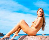 picture of nudist beach  - Stretching Stone Beauty - JPG