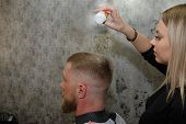 Master Barber Pours Out Styling Powder To Fix Hair. poster