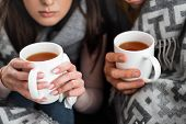 Cropped View Of Sick Girlfriend And Boyfriend Covered With Blanket Holding Cups Of Tea poster