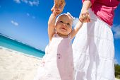 image of family fun  - Young family with baby girl on white sand tropical beach - JPG