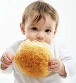 pic of toothless smile  - Baby eating bun bread - JPG