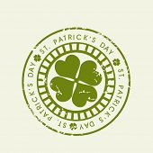 St. Patrick's Day grungy rubber stamp with shamrock leaf. EPS 10