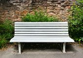 picture of banquette  - Wooden bench near a stone wall - JPG