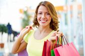 image of flirty  - Portrait of a shopping girl with flirty look - JPG