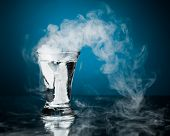 pic of vapor  - shot glass of vodka with ice vapor - JPG