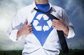 picture of button down shirt  - Businessman with open short revealing shirt with recycling symbol underneath - JPG