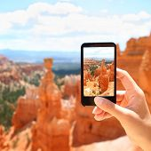 Smart phone camera taking photo picture of Bryce Canyon nature. Closeup of mobile phone camera scree