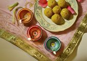 picture of laddu  - Indian sweets with traditional lamps - JPG