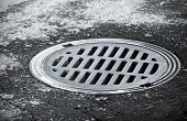 stock photo of underground water  - Sewer manhole on the urban asphalt road - JPG