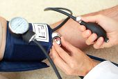 stock photo of hypertensive  - Blood pressure measuring - JPG