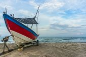 image of carron  - Traditional Fisherman Wooden Boat with blue skies - JPG
