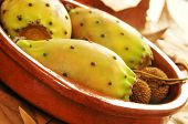 stock photo of prickly pears  - closeup of some prickly pear fruits in a earthenware bowl - JPG