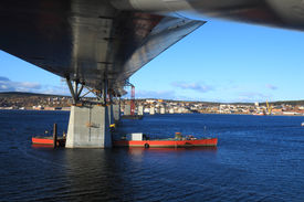 foto of flatboat  - bridge construction reaching over water view from beneath - JPG