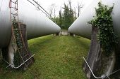 picture of oblong  - oblong tanks in industrial plant outside of the factory - JPG