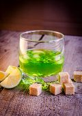 stock photo of absinthe  - Glass of absinthe with lime and sugar cubes