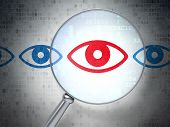 Safety concept: Eye with optical glass on digital background