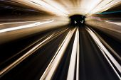 stock photo of long winding road  - Abstract image of an underground train in movement - JPG