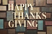 foto of give thanks  - Wooden letters forming words HAPPY THANKS GIVING written on wooden background - JPG