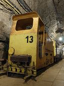 stock photo of salt mines  - Old salt mine yellow train with bogies - JPG
