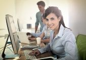 stock photo of business class  - Cheerful young woman attending business training - JPG