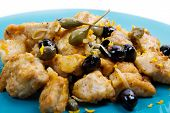 foto of swordfish  - a dish with swordfish stew with caper and olives - JPG