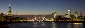 picture of late 20s  - Panoramic of the City of London with Tower Bridge The Shard Walkie Talkie Gherkin and other skyscrapers - JPG