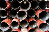 picture of box-end  - Stack of oil well intemediate casing bundles at box end of casing - JPG