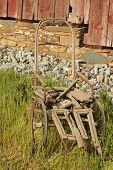 pic of antique wheelchair  - Old dilapidated wheelchair on a farm in Sutter Creek California - JPG