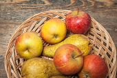 foto of indian apple  - Pumpkins apples pears tomatos and straw on a wooden plate - JPG