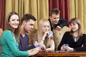 stock photo of playing card  - Group of young people  - JPG
