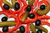 image of marinade  - Black olives marinaded cucumbers and cut paprika on the plate - JPG