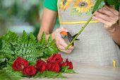image of flower shop  - Woman florist preparing bouquet flowers shop retail arranging - JPG