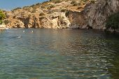 picture of piraeus  - Vouliagmeni Thermal Radonic Mineral Water Lake near Athen Greece. Just outside of Athens lies the geophysical rarity known as Lake Vouliagmeni.