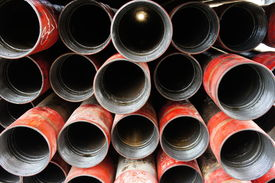 image of box-end  - Stack of oil well intemediate casing bundles at box end of casing - JPG