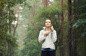 picture of early morning  - healthy lifestyle fitness sporty woman running early in the morning in forest area fitness healthy lifestyle concept - JPG