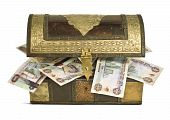 stock photo of dirham  - UAE Dirham bills popping out from an old wooden trunk - JPG