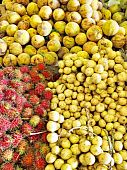 picture of lanzones  - Close up of Rambutan Santol and Lanzones fruits in an Asian market - JPG