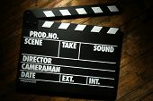 image of clapper board  - Movie clapper on wooden background - JPG