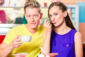 stock photo of ice cream parlor  - Couple sitting together with coffee and dish of ice cream in ice cream parlor or cafe - JPG