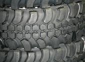 foto of four-wheel  - Four wheel drive tire stack as a background - JPG