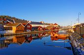 pic of hydra  - Old colorful buildings reflecting in the water - JPG