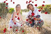 picture of serenade  - Handsome man serenading his girlfriend with guitar against valentines heart design - JPG