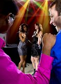 foto of soliciting  - two pickup artists harrassing women at a nightclub - JPG