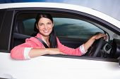 picture of car-window  - Smiling customer sitting at the wheel of a car for sale at new car showroom - JPG