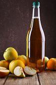 picture of vinegar  - bottle of apple vinegar with fresh apples on wooden table - JPG
