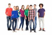 pic of adolescent  - Full length of cheerful young people smiling at camera while standing isolated on white - JPG